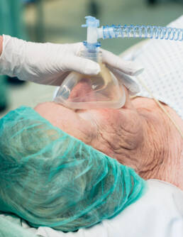 Patient being prepared for surgery in operating room